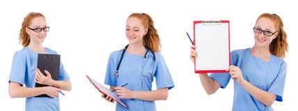 Il medico grazioso in uniforme del blu con i documenti isolati su bianco Immagini Stock Libere da Diritti