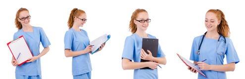 Il medico grazioso in uniforme del blu con i documenti isolati su bianco Fotografia Stock