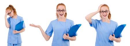 Il medico grazioso in uniforme del blu con i documenti isolati su bianco Fotografie Stock