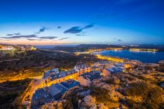 Il-Mellieha, Malta - Beautiful panoramic skyline view of Mellieha bay after sunset with blue sky and clouds Stock Images