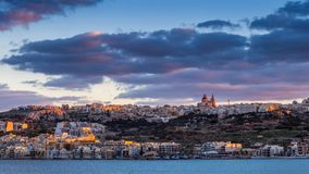 Il-Mellieha, Malta - Sunset at the beautiful mediterranean town of Mellieha with amazing sky Royalty Free Stock Photo
