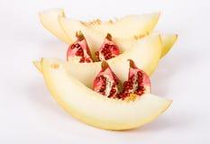Il melone ed il granato del taglio Immagini Stock