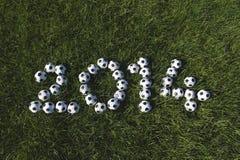 Il messaggio per 2014 ha fatto con i palloni da calcio di calcio Fotografia Stock