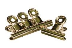Il metallo isolato copre le clip su fondo bianco con il percorso di ritaglio Fotografia Stock