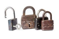 Il metallo padlocks la progettazione differente Stile dell'annata Priorità bassa bianca Immagine Stock