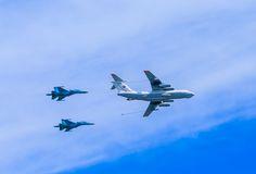 Il-78 (Midas) aerial refueling tanker demonstrates refueling of 2 Su-34 Stock Image