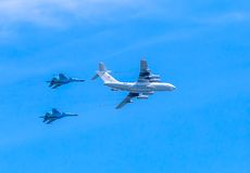 Il-78 (Midas) aerial refueling tanker  demonstrates refueling of 2 Su-34 (Fullback) Royalty Free Stock Images