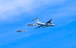 Il-78 (Midas) aerial tanker demonstrates demonstrates refueling of 2 Su-24 (Fencer) Stock Images