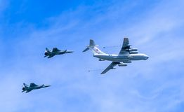 Il-78 (Midas) aerial tanker demonstrates  refueling of 2 MiG-31 Royalty Free Stock Photo