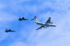 Il-78 (Midas) aerial tanker demonstrates refueling of 2 MiG-31 (Foxhound) Royalty Free Stock Photo