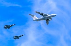 Il-78 (Midas) aerial tanker demonstrates refueling of 2 MiG-31 (Foxhound) Royalty Free Stock Photography