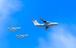 Il-78 (Midas) aerial tanker demonstrates refueling of 2 Su-24 Stock Photography
