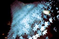 Il modello astratto del chiarore della lente e del bokeh in stella modella con il filtro d'annata Fotografia Stock Libera da Diritti