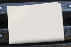 Il modello del giornale su un fondo di legno Fotografia Stock Libera da Diritti