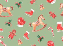 il modello dell'acquerello con il Natale gioca su un fondo colorato fotografia stock