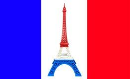 Il modello della torre Eiffel con la banda blu bianca rossa stampata dalla stampante 3D sulla bandiera della Francia, prega per i Fotografie Stock