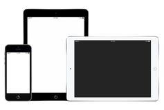 Il modello dello smartphone e due riducono in pani i computer in ritratto e La Immagine Stock