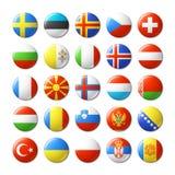 Il mondo diminuisce intorno ai distintivi, magneti europa Fotografie Stock