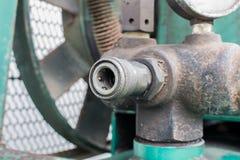 Il montaggio/accoppiatore rapidi con il compressore d'aria Fotografie Stock