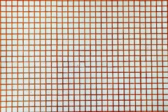 Il mosaico delle mattonelle della parete con l'arancia cuce la struttura immagini stock libere da diritti