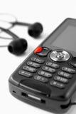 Il MP3 telefono-gode della musica mobile Fotografie Stock