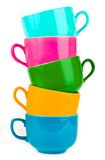 Il mucchio delle tazze ceramiche variopinte Fotografia Stock