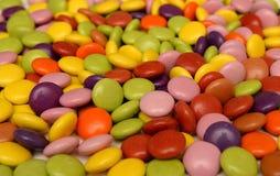 Il mucchio dello zucchero ha costeggiato i dolci Fotografia Stock