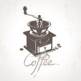 Il mulino di caffè con alcuni chicchi di caffè Immagini Stock Libere da Diritti