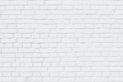 Il muro di mattoni ha dipinto la calce bianca come un fondo o contesto Fotografia Stock