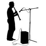 Il musicista della siluetta gioca il clarinetto Fotografie Stock Libere da Diritti