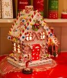Il Natale alloggia illuminato dentro Immagine Stock