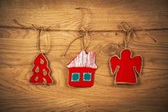 Il Natale alloggia su fondo di legno Fotografia Stock Libera da Diritti