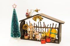 Il Natale di legno compera con Santa e raindeer isolati su fondo bianco fotografia stock