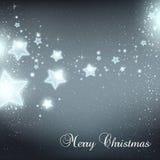 Il Natale ed il nuovo anno stars per la celebrazione su fondo scuro con i punti leggeri, fiocchi di neve illustrazione vettoriale