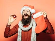Il Natale equipaggia con la calza decorativa Fotografia Stock