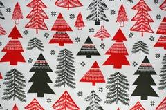 Il Natale ha disegnato l'ornamento di struttura con gli alberi neri e rossi Fotografia Stock