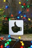 Il Natale sfoglia sull'icona su fondo di legno Fotografie Stock Libere da Diritti