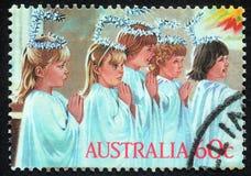 Il Natale timbra stampato nel gioco di bambini di manifestazioni dell'Australia alla famiglia santa Fotografia Stock Libera da Diritti