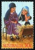 Il Natale timbra stampato nel gioco di bambini di manifestazioni dell'Australia alla famiglia santa Immagini Stock Libere da Diritti