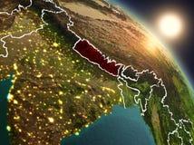Il Nepal da spazio durante l'alba Fotografia Stock