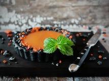 Il nero acido della zucca casalinga per Halloween fotografia stock