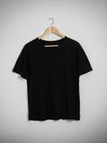 Il nero della maglietta Immagine Stock