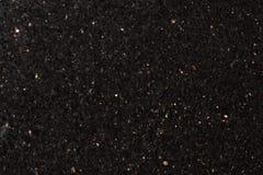 Il nero di pietra naturale extra, granito nero, particelle brillanti della galassia della stella fotografia stock libera da diritti