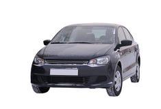 Il nero di Volkswagen Polo dell'automobile su un fondo bianco Immagine Stock