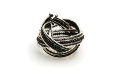 Il nero e braccialetto d'avanguardia dell'argento su bianco Fotografie Stock Libere da Diritti