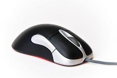 Il nero e mouse ottico del calcolatore collegato argento fotografie stock
