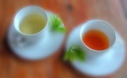 Il nero e tè verde della sfuocatura Fotografia Stock Libera da Diritti