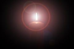 Il nero isolato luce della candela Fotografia Stock