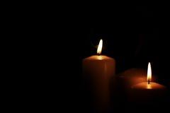 Il nero leggero della candela Immagine Stock