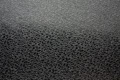 Il nero lucido di struttura granulare artificiale del tessuto Fotografia Stock Libera da Diritti